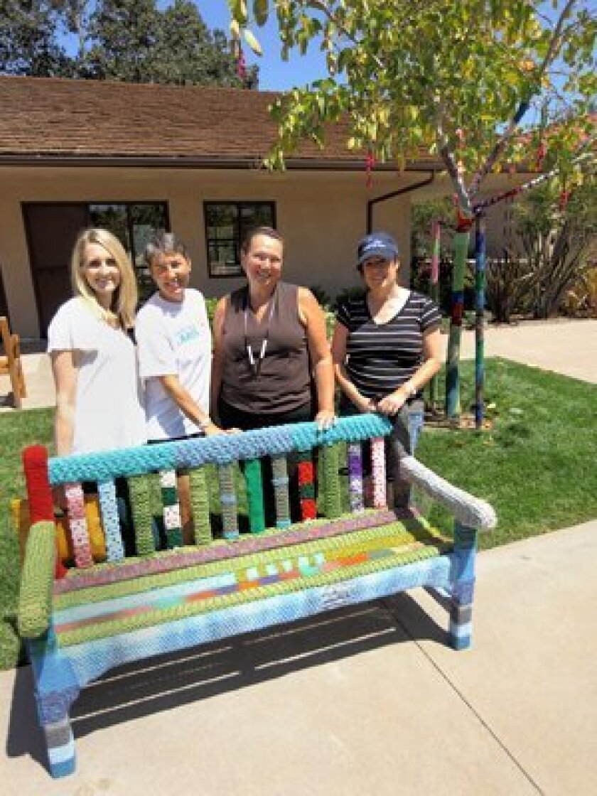 """Imagine their """"surprise"""" when Heike Mannix, Kathy Hewitt, Marsha Wenskay, and Jennifer See discovered the international 'Yarn Bomb' phenomenon at the RSF Village Church."""