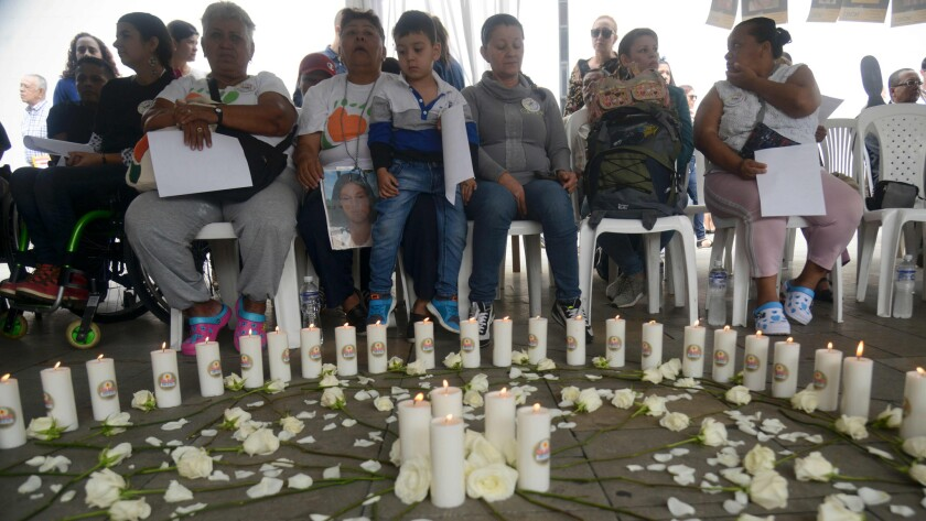 Relatives of missing people and other people affected by the Colombian conflict attend the International Day of the Disappeared in Medellin, Antioquia Department, Colombia, on August 30, 2016.