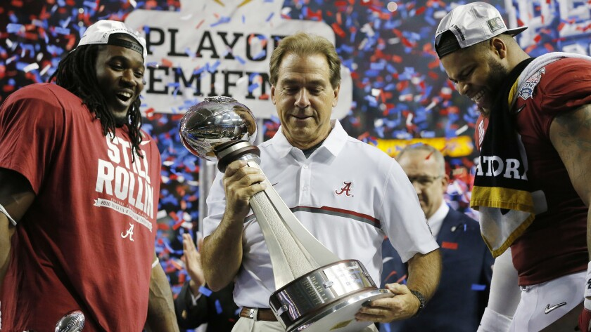 Coach Nick Saban, flanked by Bo Scarbrough, left, and Ryan Anderson celebrates after Alabama's victory in the Peach Bowl on Saturday.