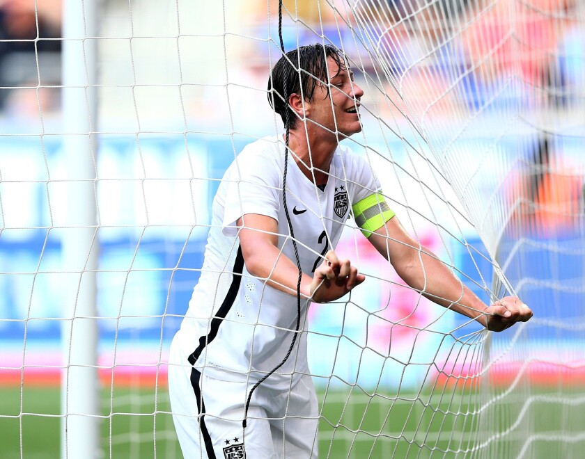U.S. forward Abby Wambach reacts after missing a shot against South Korea in her team's final tuneup for the World Cup.