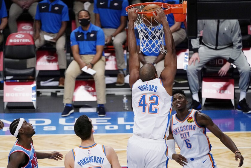 Oklahoma City Thunder guard Hamidou Diallo (6) watches as Thunder center Al Horford (42) dunks with no opposition as Brooklyn Nets guard Caris LeVert, far left, looks on during the second quarter of an NBA basketball game Sunday, Jan. 10, 2021, in New York. (AP Photo/Kathy Willens)