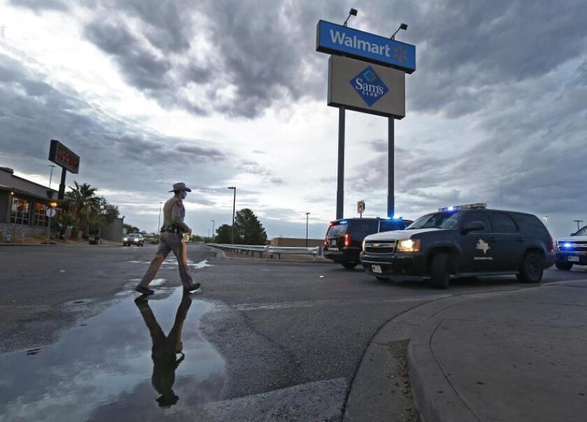 A Texas State Trooper walks back to his vehicle blocking a road outside while investigating the mass shooting at a Walmart in El Paso, Texas, USA. EFE/EPA/Larry W. Smith/File
