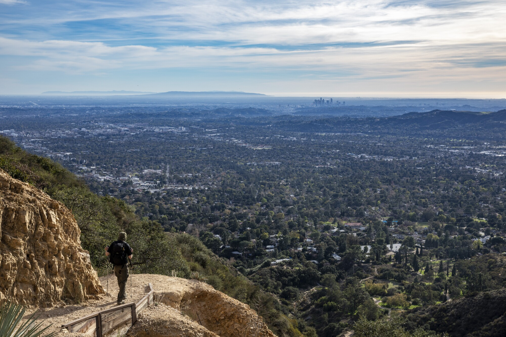 A hiker takes in the views from atop Echo Mountain.