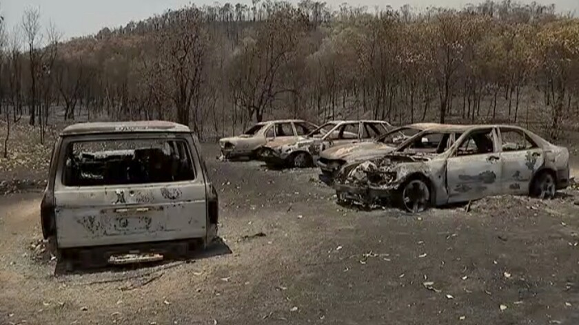 An image from video shows vehicles that were charred by wildfires in Yeppoon, a town in Queensland state, Australia.