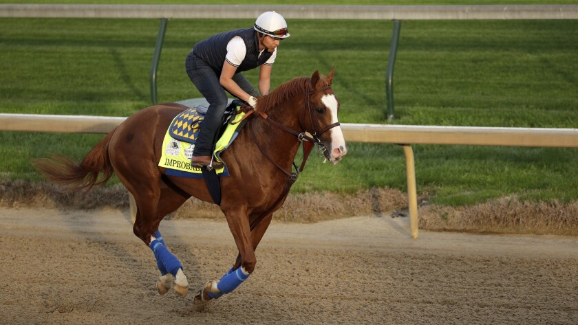 Kentucky Derby entrant Improbable runs during a workout at Churchill Downs Wednesday, May 1, 2019, i