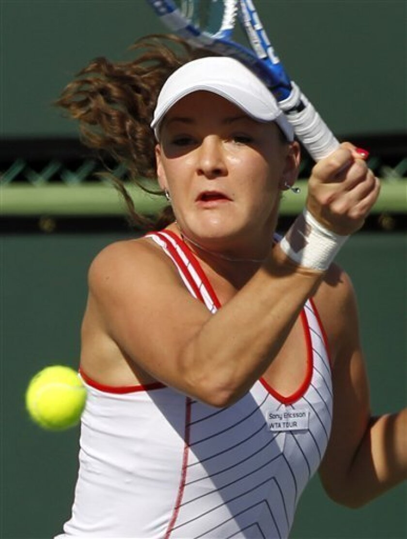 Agnieszka Radwanska, of Poland, returns a shot in their doubles match with Maria Kirilenko of Russia, against Lisa Raymond and Rennae Stubbs during the BNP Paribas Open tennis tournament in Indian Wells, Calif., Thursday, March 11, 2010. (AP Photo/Chris Carlson)
