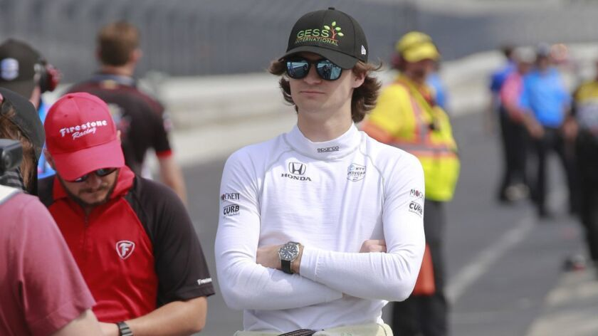 Colton Herta waits in the pit area for the start of the final practice session for the Indianapolis