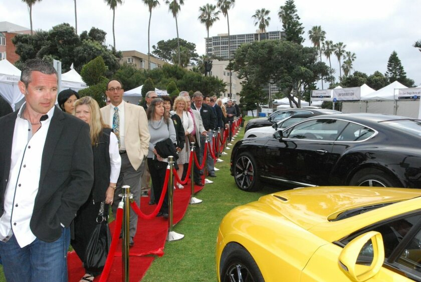 People enter Scripps Park for Saturday Night's VIP party during last year's Concours weekend. This year's party, sponsored by Aston Martin, will be from 6-9 p.m. April 11 in the park.