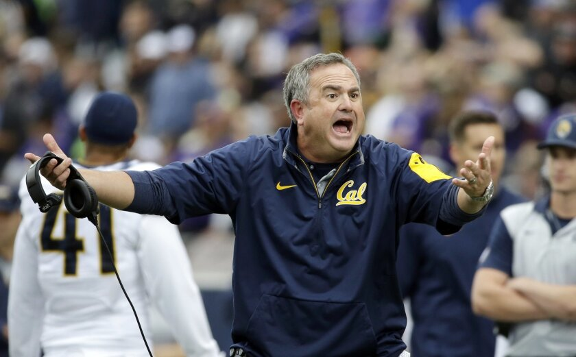 California head coach Sonny Dykes reacts to a call by officials during the first half an NCAA college football game against Washington, Saturday, Sept. 26, 2015, in Seattle. Cal won 30-24. (AP Photo/Elaine Thompson)