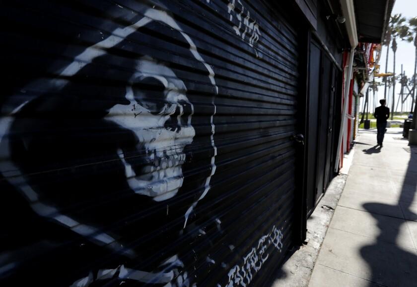 Shuttered shops line Windward Avenue in Venice Beach