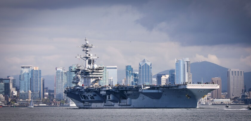 The aircraft carrier USS Theodore Roosevelt, flagship of Carrier Strike Group 9, travels through San Diego Bay as seen from Shelter Island after leaving Naval Air Station North Island, starting a scheduled deployment to the U.S. Indo-Pacific Command region, January 17, 2020 in San Diego, California.