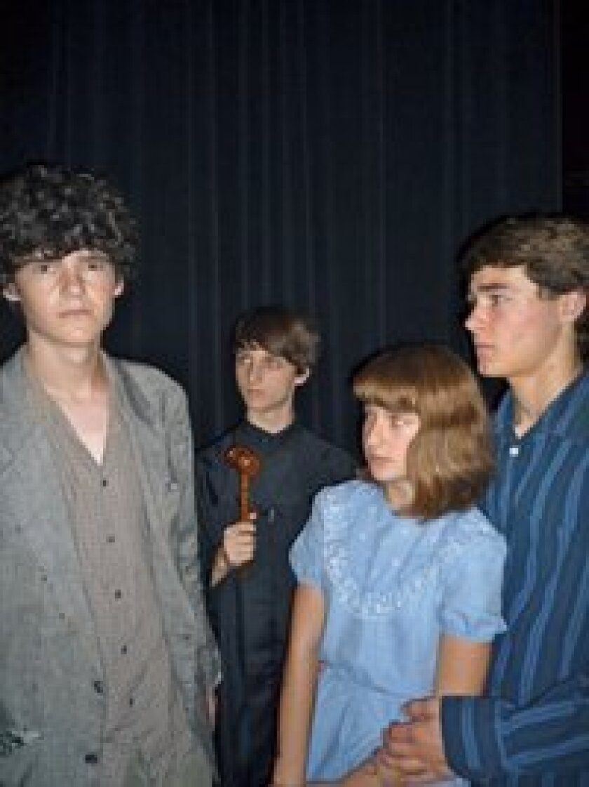 """(From left to right) Ben Sutton as Skelly, Julian Coker as the Judge/Preacher, Marie Osterman as Eva Jackson and Troy Lingelbach as Robert Conkling in CCA's """"The Rimers of Eldritch."""""""