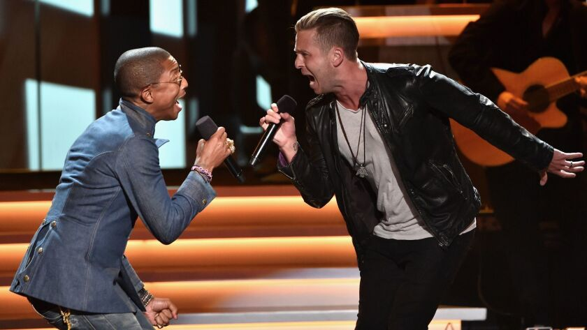 Ryan Tedder, right, performs with Pharrell Williams in 2015 at a Grammy Awards tribute to Stevie Wonder.