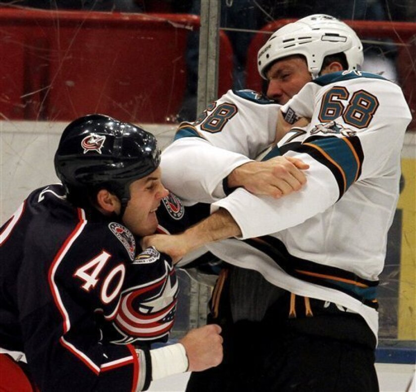 Columbus Blue Jackets' Jared Boll, left, fights with San Jose Sharks' Frazer McLaren during the first period of a NHL hockey game against Columbus Blue Jackets, in Stockholm, Sweden, Friday, Oct. 8, 2010. (AP Photo / Niklas Larsson)