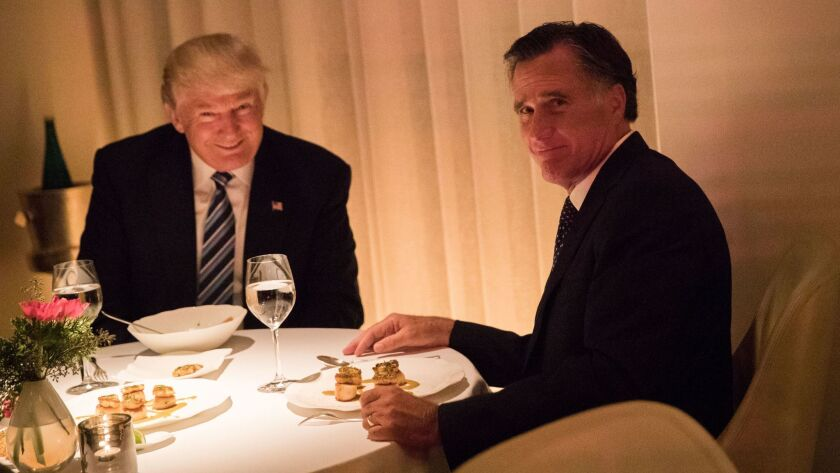 Donald Trump and Mitt Romney dine in New York on Nov. 29, 2016, as Trump was pondering whether to add his longtime opponent to his Cabinet.