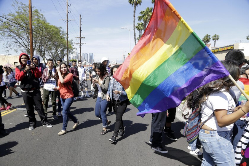 Students rally outside Santee Education Complex in South Los Angeles on Wednesday in support of the school's gender-neutral bathroom and the students who advocated for it. Some students had fought with protesters outside the school Tuesday.