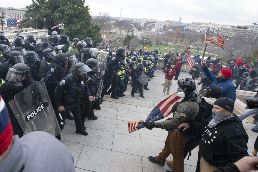 U.S. Capitol Police push back rioters Wednesday in Washington.