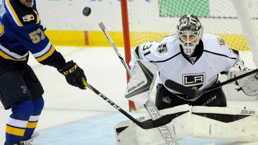 Kings goalie Peter Budaj blocks a shot from St. Louis' David Perron during the second period of a game on Oct. 29.