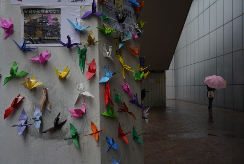 Paper origami cranes are displayed during a sit-in outside police headquarters in Hong Kong Monday, Oct. 14, 2019. The protests that started in June over a now-shelved extradition bill have since snowballed into an anti-China campaign amid anger over what many view as Beijing's interference in Hong Kong's autonomy that was granted when the former British colony returned to Chinese rule in 1997. (AP Photo/Vincent Yu)