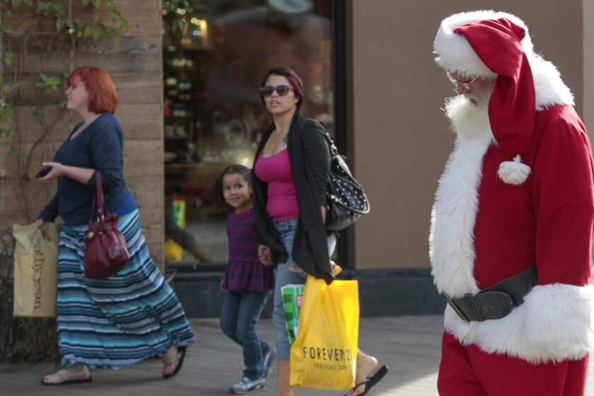 Retailers are playing less Christmas music this year in an effort to appeal to more customers.