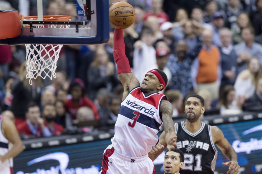 Wizards guard Bradley Beal (3) goes up for a dunk in front of Spurs center Tim Duncan (21) during the second half.