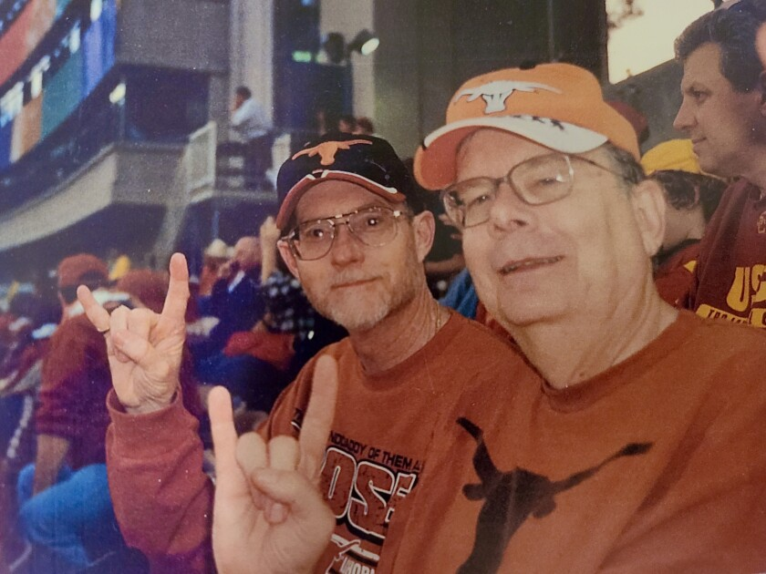 """Don Hunt and his cousin Phil Worley make the """"Hook 'em Horns"""" gesture at the 2006 Rose Bowl game."""