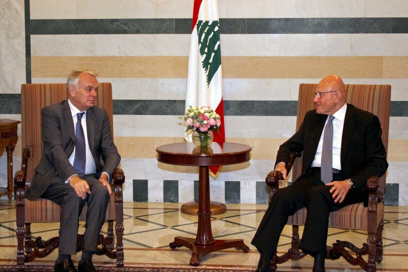 In this photo released by Lebanon's official government photographer Dalati Nohra, Lebanese Prime Minister Tammam Salam, right, meets with French Foreign Minister Jean-Marc Ayrault, left, at the government House, in Beirut, Lebanon, Tuesday, July 12, 2016. Ayrault said his country will do everythin