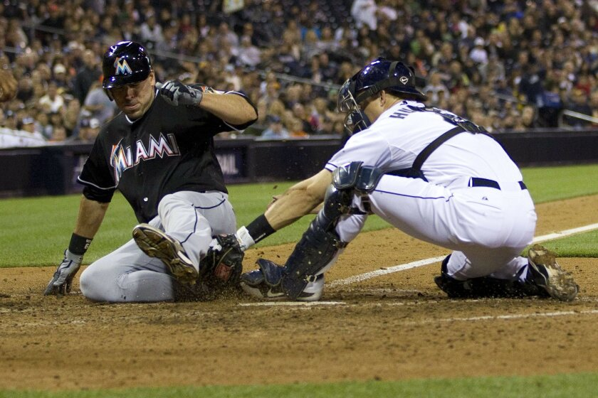 Marlins #29 Gregg Dobbs scores the go-ahead run in the 7th beating Nick Hundley tag.