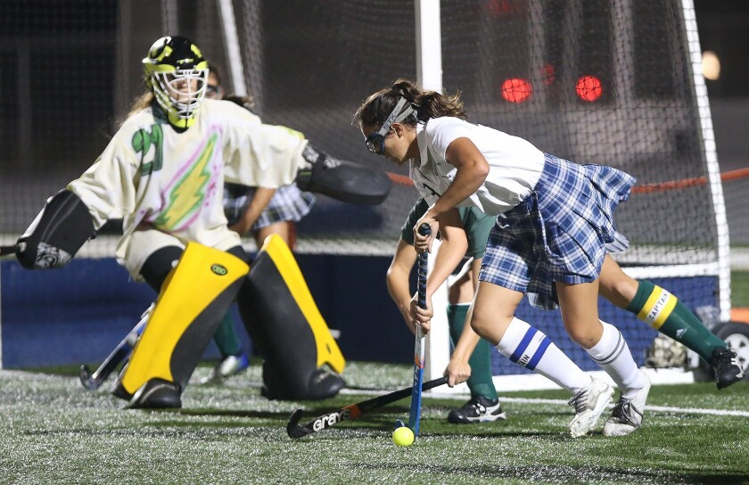 Newport Harbor's Delaney Knipp, right, battles for position to get a shot off as Edison goalie Mary