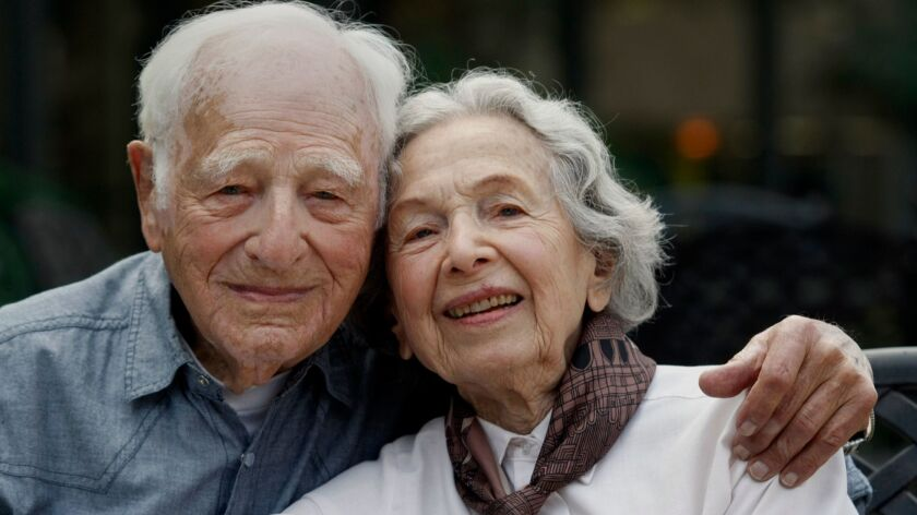 LOS ANGELES, CALIFORNIA - SEPTEMBER 19, 2013: Morrie Markoff, 99, and his wife Betty, 97, are photog