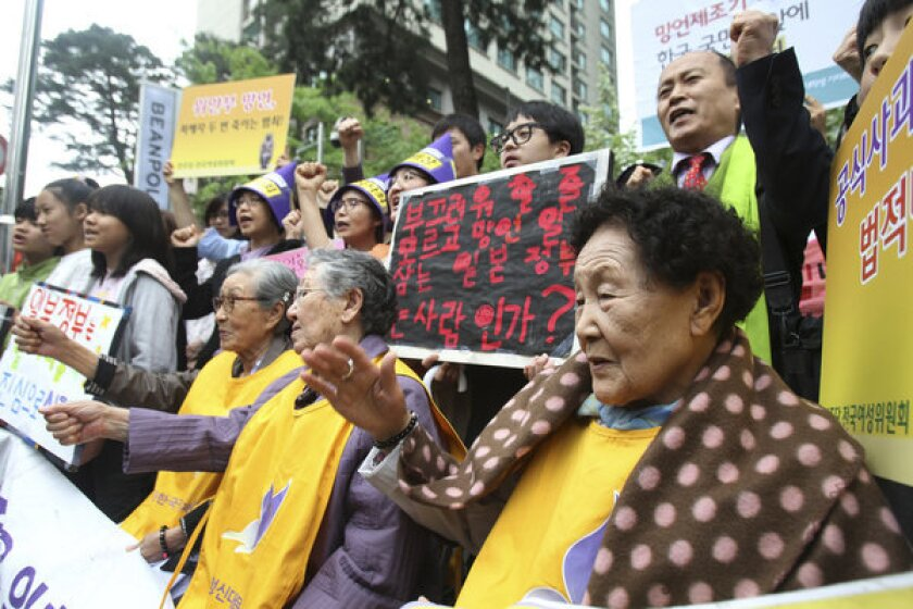 "South Korean women used as sex slaves by Japanese soldiers during World War II rallied outside the Japanese Embassy in Seoul to protest Japanese politicians' recent comments diminishing their abuse. The plight of the so-called comfort women is a subject of the novel ""Sunday Girl"" by Korean American writer Kalliope Lee."