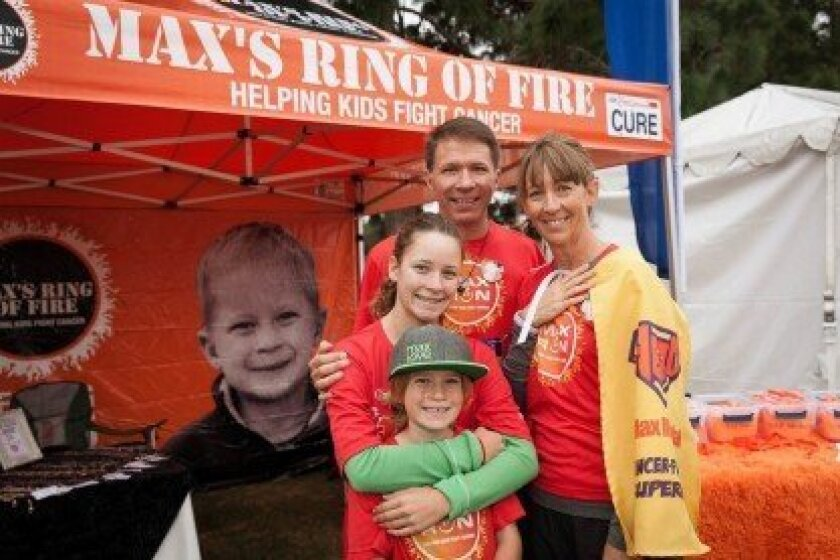 The Mikulak family at the Run to Fight Children's Cancer (Max Mikulak is shown in a large photo on the left). Courtesy photo