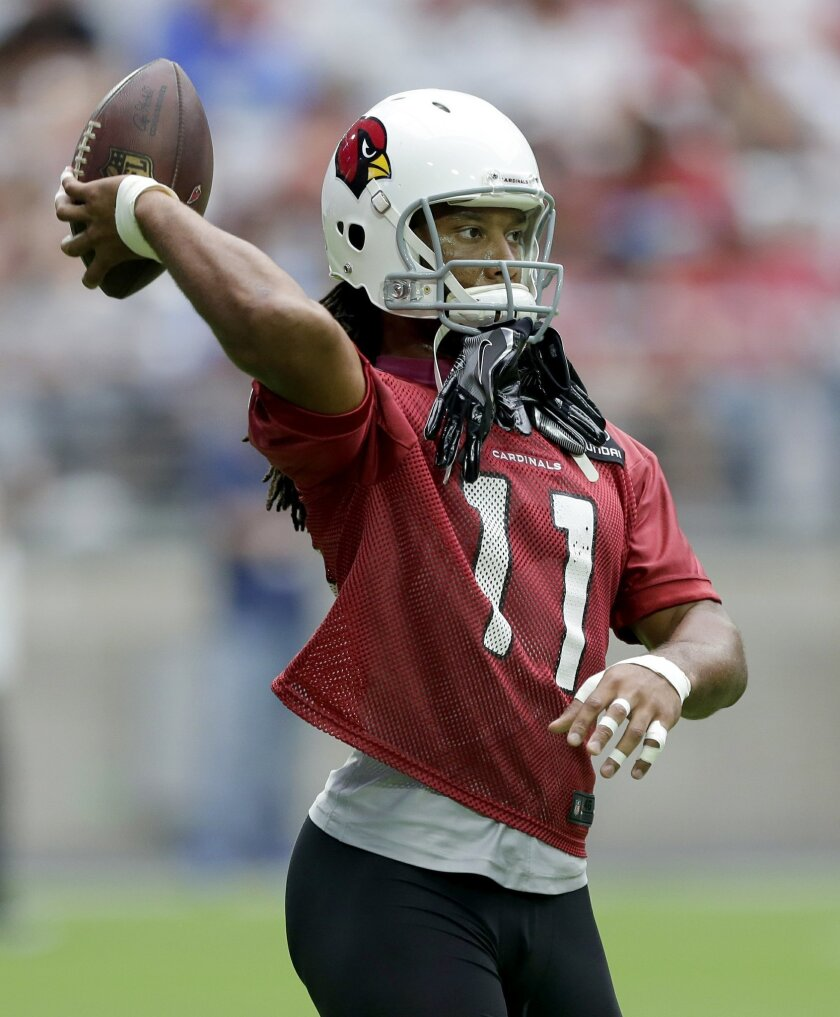 Arizona Cardinals' Larry Fitzgerald throws the ball during practice at the NFL football team's training camp, Friday, July 29, 2016, in Glendale, Ariz. (AP Photo/Matt York)