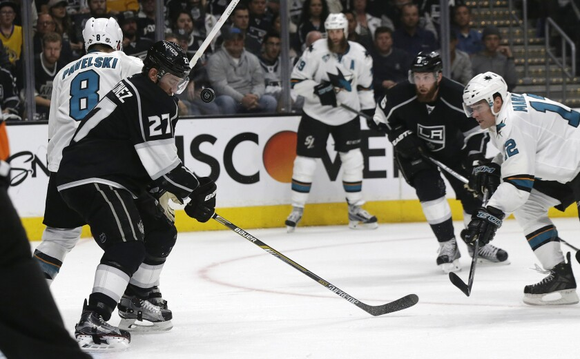Kings defenseman Alec Martinez gets an eye-level view of the puck against the Sharks in the second period.