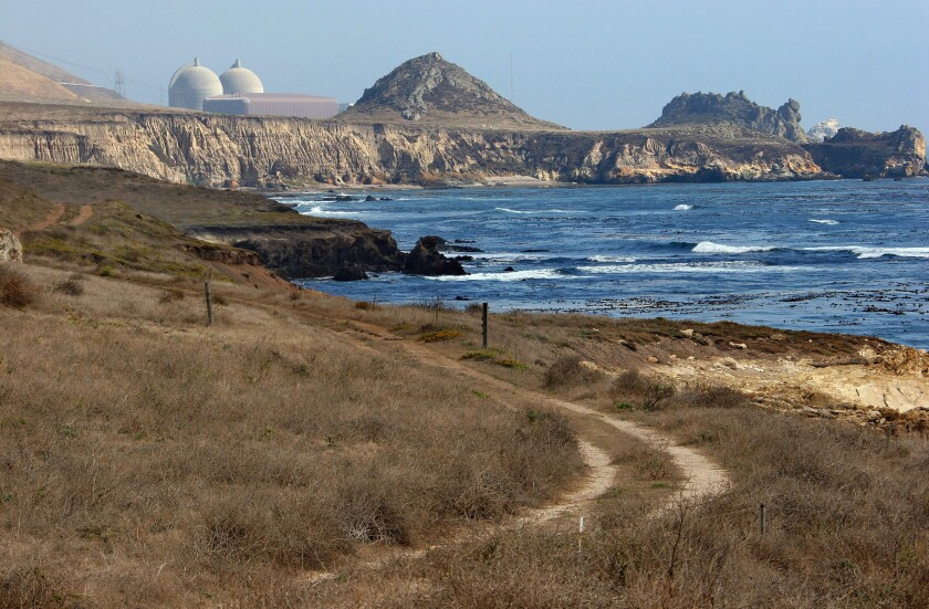 The reactor containment structures of the Diablo Canyon nuclear power plant rise amid seaside cliffs in Avila Beach.