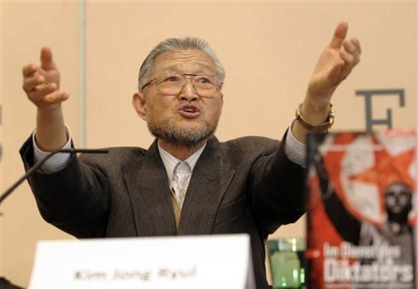 "Former highly decorated North Korean colonel Kim Jong Ryul gestures at a news conference in Vienna, on Thursday, March 4, 2010, on the occasion of the presentation of the book ""Im Dienst des Diktators"" (""At the Dictator's Service"") by Ingrid Steiner-Gashi and Dardan Gashi. The highly decorated North Korean colonel who spent two decades going on European shopping sprees for his country's rulers has revealed how the late dictator Kim Il Sung lived in luxury and pampered himself with expensive cars and delicacies as the hungry masses outside his opulent palaces struggled to survive. (AP Photo/Hans Punz)"