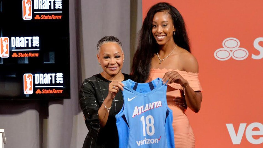 NEW YORK, NY - APRIL 12: Monique Billings stands with WNBA President Lisa Borders after being selec