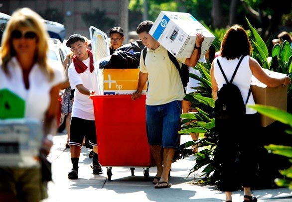 It's move-in day for freshman Graham Oyoung, left, at USC in Los Angeles. His friend Andrew Butt, right, gives him a hand.