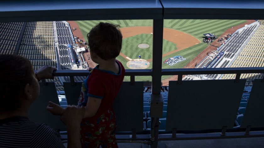 LOS ANGELES, CA - OCTOBER 25, 2018: Dodger fans watch grounds crew prepare the field at the Top of