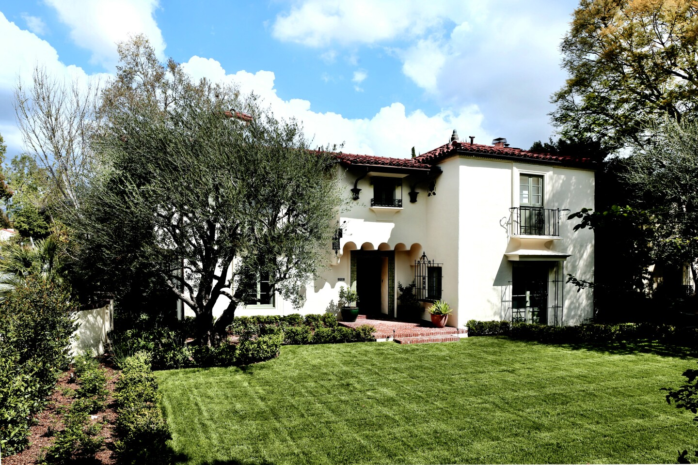 A stellar example of the Spanish Colonial Revival style, the graceful residence was originally designed by Harold J. Bissner and recently renovated by Kevin A. Clarke. Moorish accents, Juliet balconies and a classic clay-tile roof are among features of the home, listed for $4.25 million. Decorative Mission-style tilework is a hallmark both inside and out.