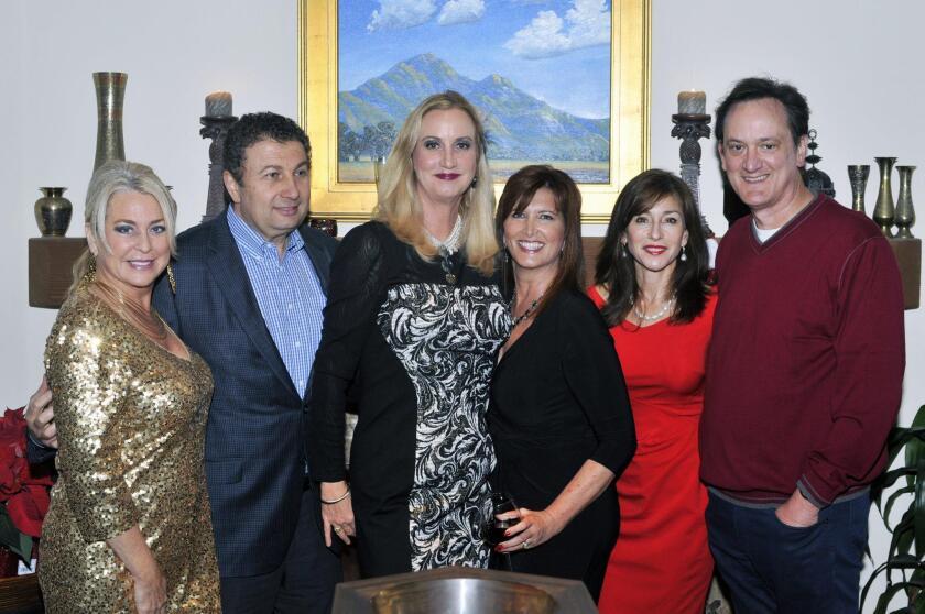 Carrie Woodland, Hosts Louay and Sophia Alsadek, board member/PR & Marketing Director Annette Fargo, Judy and Steve Rowles