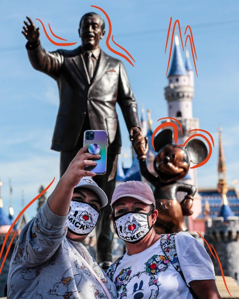Park visitors in front of the Walt Disney statue at Disneyland.