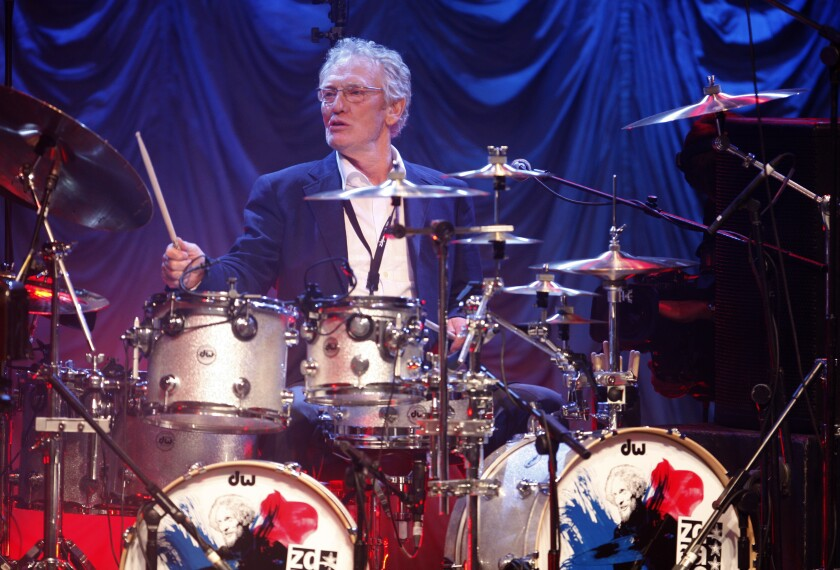 In this Sunday, Dec. 7, 2008, file photo, British musician Ginger Baker performs at the 'Zildjian Drummers Achievement Awards' at the Shepherd's Bush Empire in London. The family of drummer Ginger Baker, the volatile and propulsive British musician who was best known for his time with the power trio Cream, says he died, Sunday Oct. 6, 2019. He was 80.