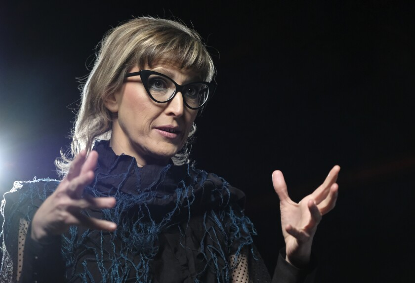 """Bosnian filmmaker Jasmila Zbanic speaks and gestures during an interview with the Associated Press in the capital Sarajevo, Bosnia, Saturday, Jan. 30, 2021. Zbanic's latest and the most ambitious film """"Quo Vadis, Aida?"""", based on true events from Bosnia's brutal 1992-95 inter-ethnic war has been many years in the making. (AP Photo/Kemal Softic)"""