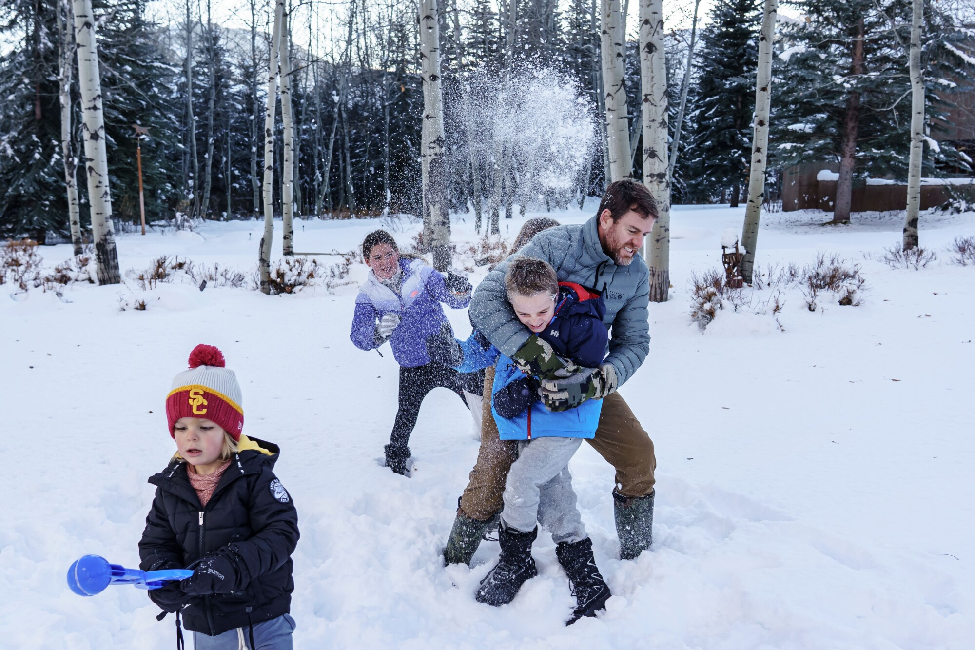 Carson Palmer gets hammered with a snowball as he tries to take a portrait with his children.