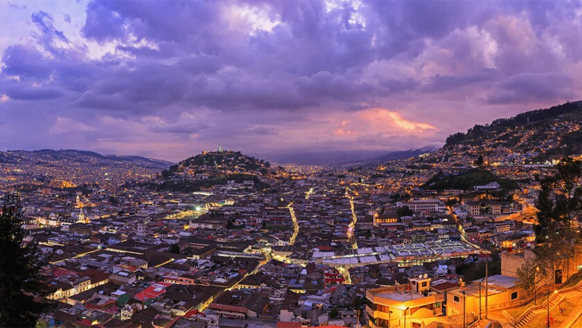 Ecuador, Quito, cityscape at sunset. Two airlines are offering $320 round-trip fares from LAX to the capital city.
