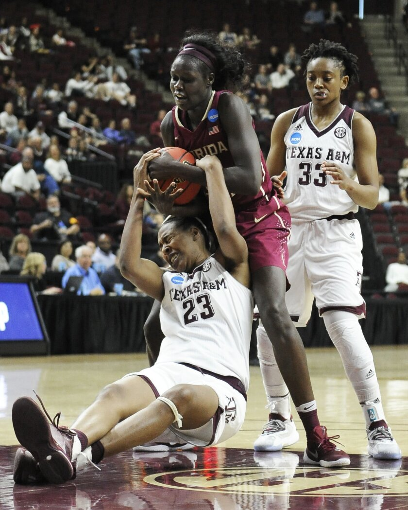 Texas A&M's Rachel Mitchell (23) and Florida State's Adut Bulgak, center battle for possession as Courtney Walker (33) looks on during the second half of a college basketball game in the second round of the NCAA tournament Monday, March 21, 2016, in College Station, Texas. Florida State won 74-56. (AP Photo/Pat Sullivan)