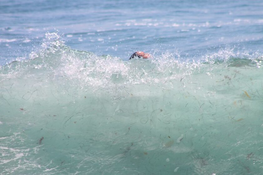 Strong rip currents and a thumping shorebreak at Windansea.