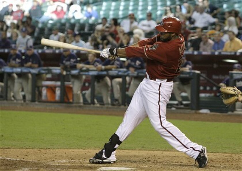 Arizona Diamondbacks' Brandon Allen connects for a grand slam against the San Diego Padres during the seventh inning of a baseball game Wednesday, Sept. 1, 2010, in Phoenix. (AP Photo/Ross D. Franklin)