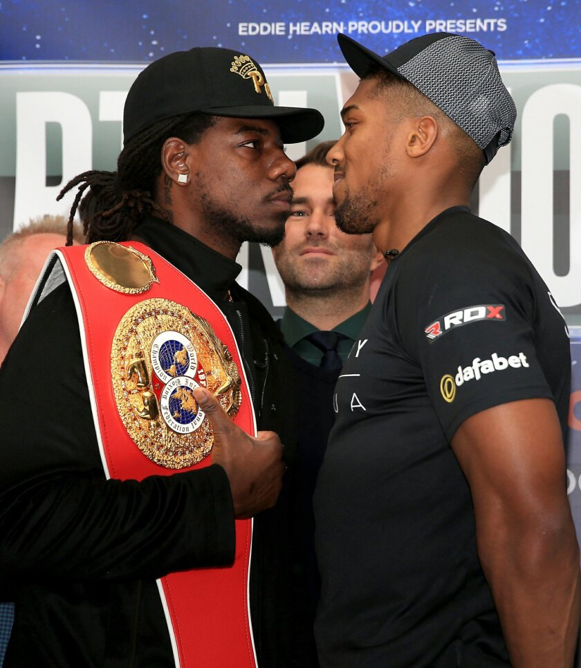U.S. heavyweight boxer Charles Martin, left, stands nose to nose with British heavyweight Anthony Joshua, during press conference at the Dorchester Hotel, London. Friday Feb. 19, 2016. Martin is in London to promote his heavyweight world title fight against Britain's Anthony Joshua in London on Apr